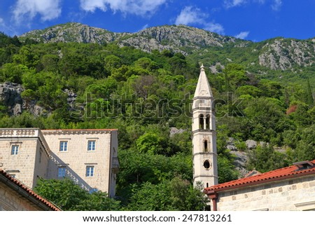 Tall church tower with Romanesque architecture in Perast, Montenegro