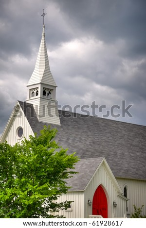 Tall Church with a Vibrant Red Door