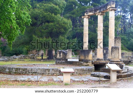 Tall columns in the ancient sanctuary at Olympia, Greece - stock photo