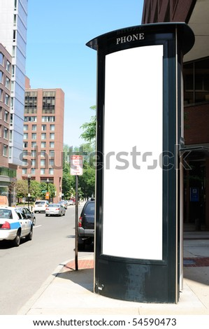 Tall commercial sign on telephone booth. Clipping path included. - stock photo