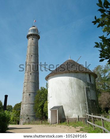 Tall concrete lighthouse - stock photo