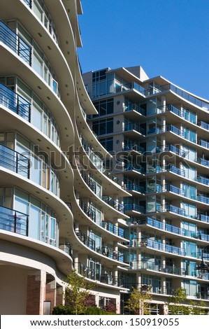 Tall condominium or apartment building in the city downtown. - stock photo