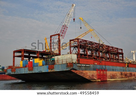 tall crane and ship at the shipyard