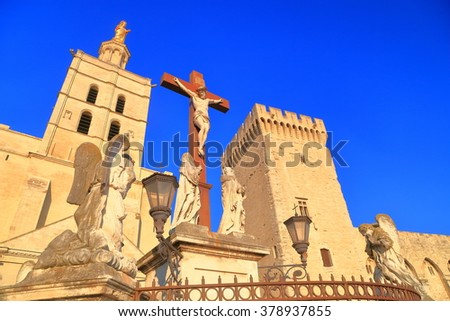 Tall cross in front of the Avignon Cathedral, Provence, France - stock photo