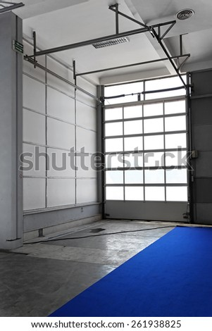 Tall doors for trucks at distribution warehouse - stock photo