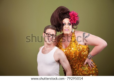 Tall drag queen with shorter man in glasses