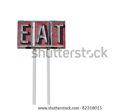 Tall eat sign ruin along a California desert highway. - stock photo
