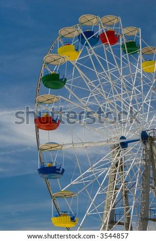 Tall Ferris wheel against sky background - stock photo