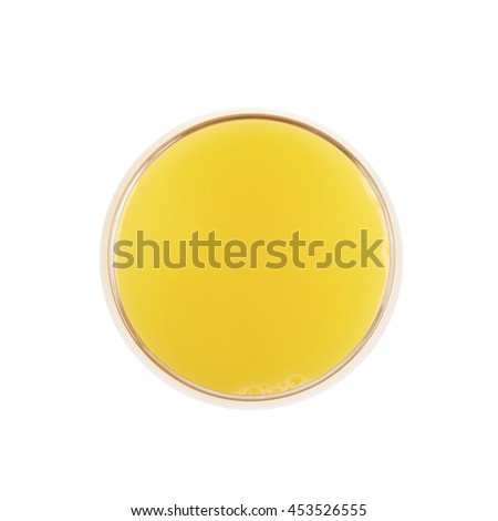 Tall glass filled with orange juice isolated over the white background, top view above foreshortening - stock photo