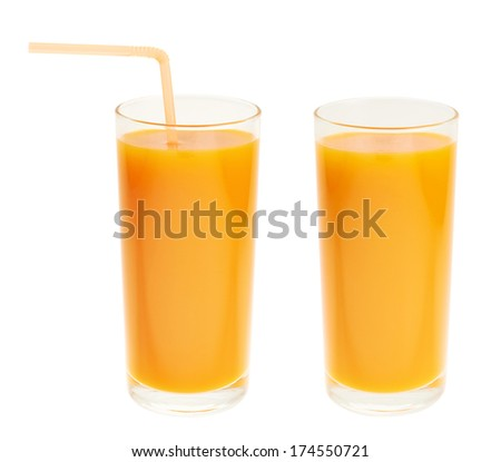 Tall glass full of orange carrot juice isolated over white background, set of two, with and without a drinking straw - stock photo