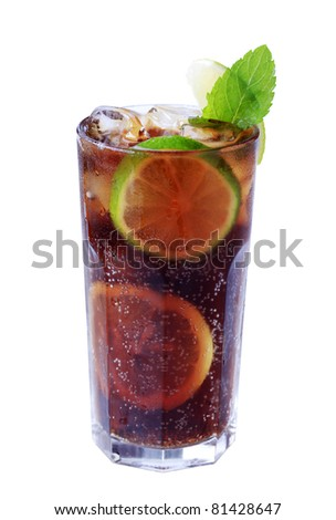 Tall glass of iced drink with slices of lime