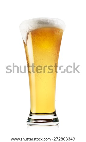 Tall glass of light beer with foam isolated on a white background