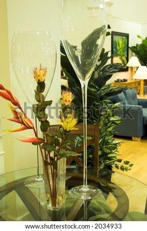 tall glasses and floweres on table - stock photo