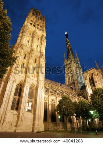 Tall gothic building of Rouen Cathedral at night