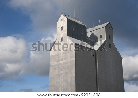Tall grain elevator in rural countryside of America