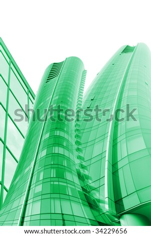 Tall green office buildings with glass windows