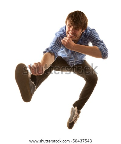 Tall handsome hipster man on white background jumping - stock photo
