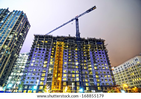 tall highrise building under construction in a big city - stock photo