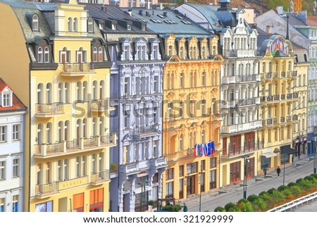Tall hotels and traditional buildings on sunny street in Karlovy Vary, Czech Republic - stock photo