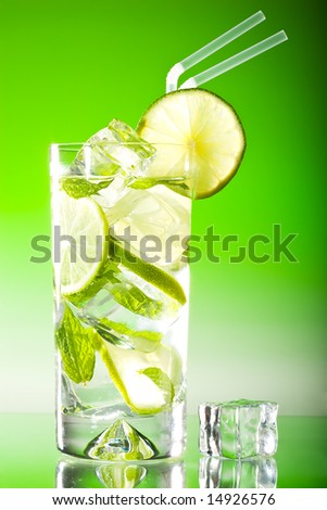 Tall iced mojito with lime and mint - stock photo