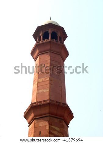 Tall Minaret of Badshahi Mosque in Lahore. Measuring more than minaret of Taj Mahal in Agra, India. - stock photo