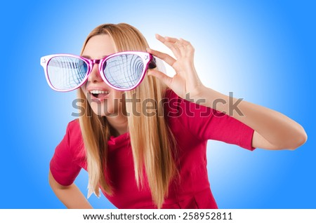 Tall model with giant sunglasses  - stock photo