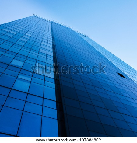 Tall modern office building over clear blue sky