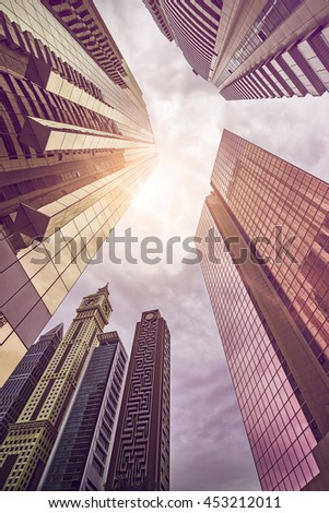 tall office and hotel buildings in the evening sun in downtown Dubai, UAE - stock photo