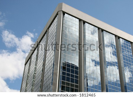 Tall office building on a cloudy day - stock photo