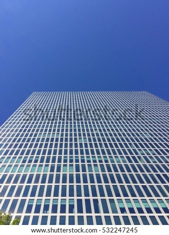 tall office building under blue sky