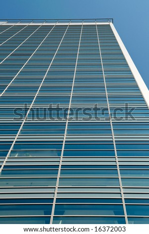 tall office building with clear blue sky background