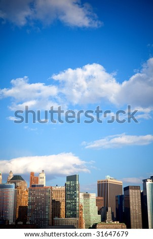 tall office buildings in a big city with a blue sky on the background