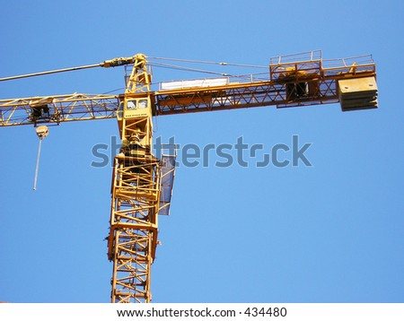 Tall orange crane in the sky, constructing building