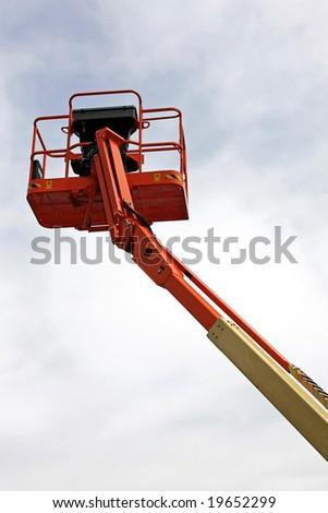 Tall orange crane platform for construction industry - stock photo