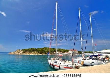 Tall sail boats near the shore of the Adriatic sea, Makarska, Croatia - stock photo