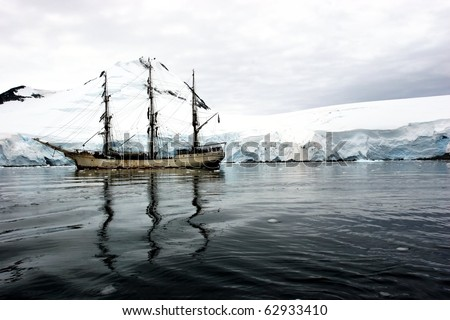 Tall sailing ship with three masts in Antarctica - stock photo