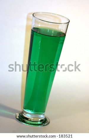 Tall schooner glass filled with green beer - stock photo
