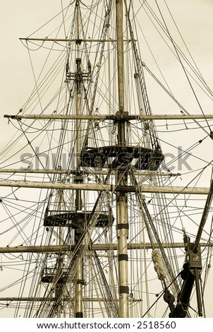Tall ship rigging in sepia - stock photo