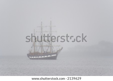 Tall ship seen in the morning mist