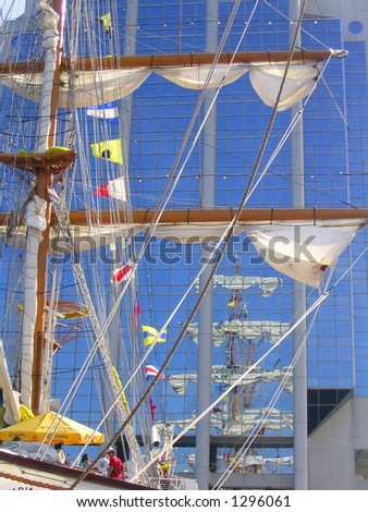 Tall Ship Spars and Flags Reflected - stock photo
