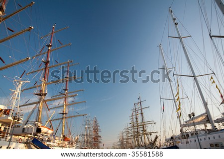 Tall ships parade in Klaipeda port during 2009 races - stock photo