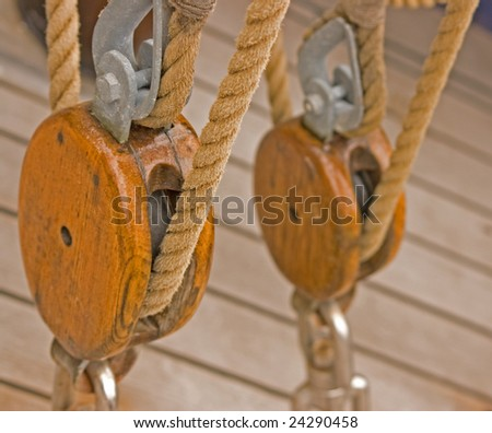 Tall ships rigging with winch and ropes - stock photo