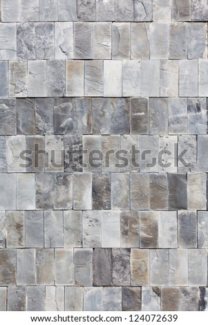 Tall shot of uneven marble tiles texture - stock photo
