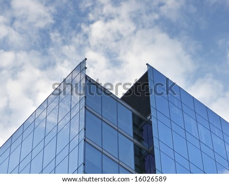 tall skyscraper with cloudy blue background - stock photo