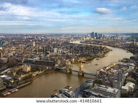 Tall skyscrapers and churches compete for light on the banks of the Thames in London - stock photo