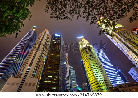 Tall skyscrapers of the big modern city. View from the foot - stock photo
