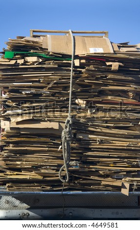 Tall stack of flattened cardboard boxes for recycling - stock photo