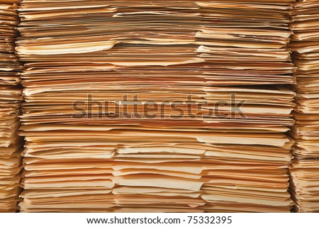 Tall stack of paper legal file folders. - stock photo