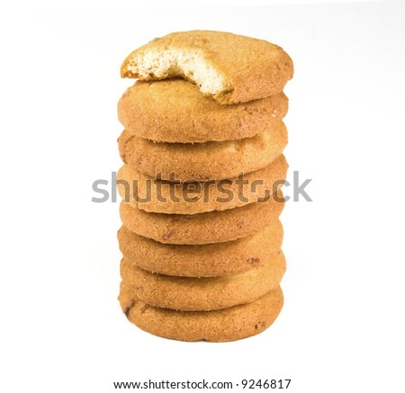 Tall tower of cookies on white background - stock photo