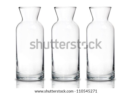 Tall transparent glass jug on white background - stock photo